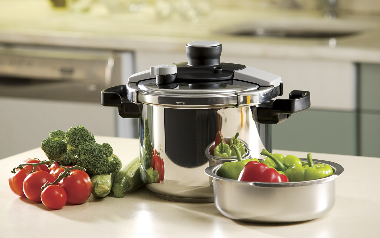 pressure cooker and vegetables in the kitchen