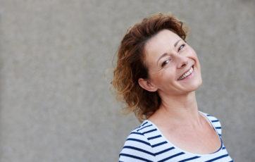 smiling woman wearing striped shirt