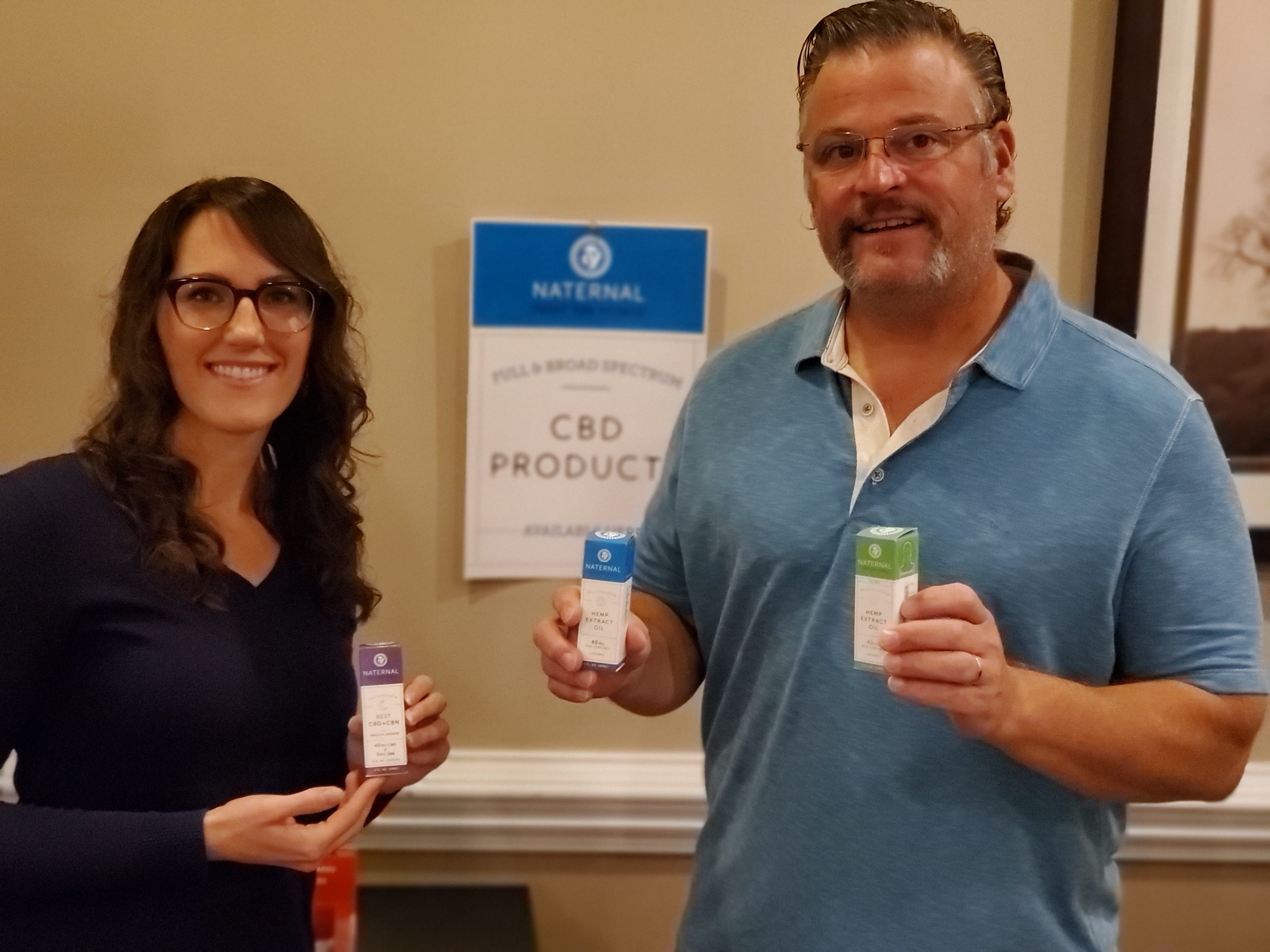 Dr. Simonds and Michelle Kennedy, NP-C holding CBD products