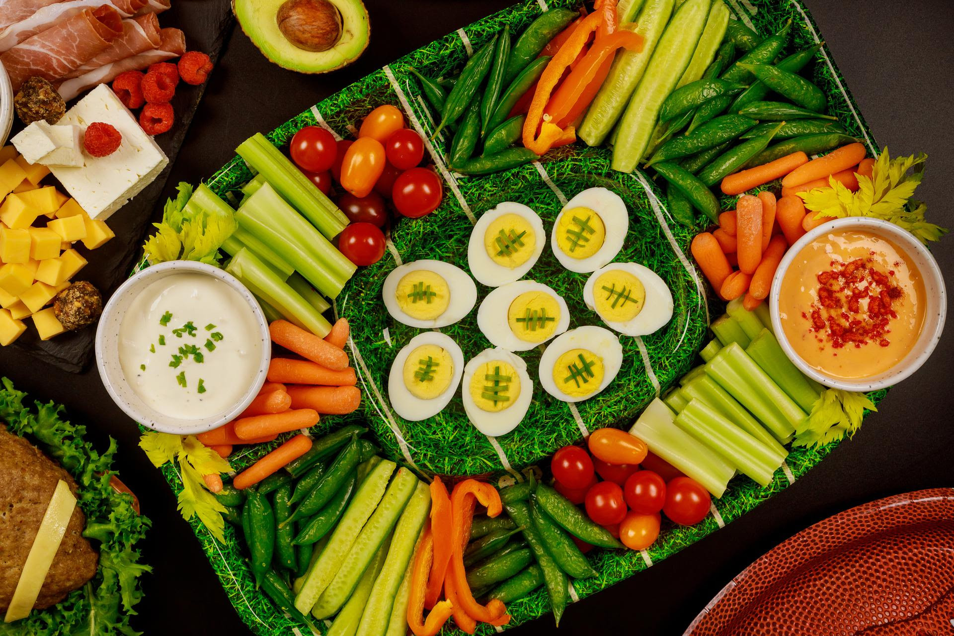 Platter of various vegetables, dips and deviled eggs