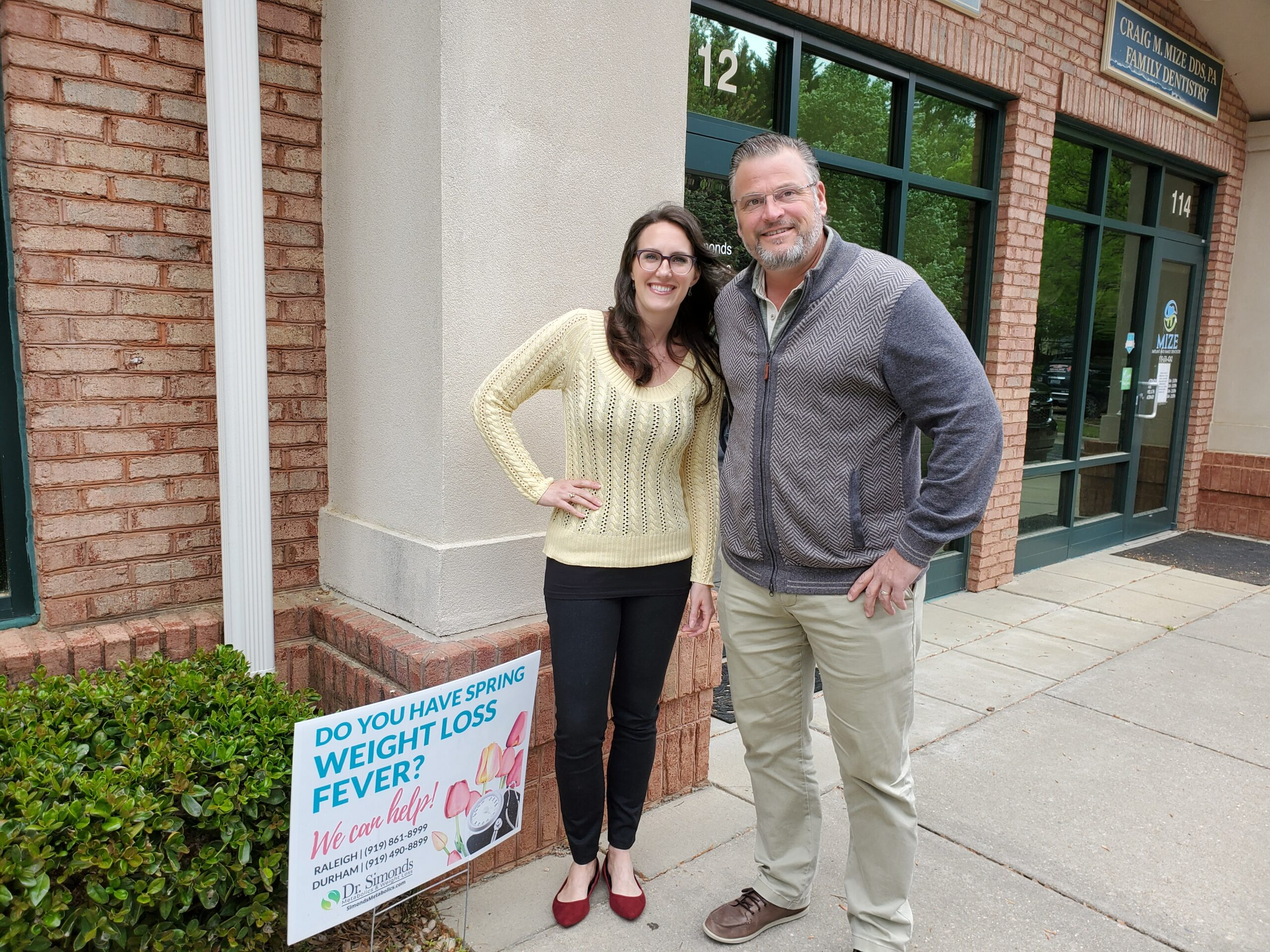 Michelle Kennedy, NP-C and Dr. Wickham Simonds standing outside of Raleigh office.