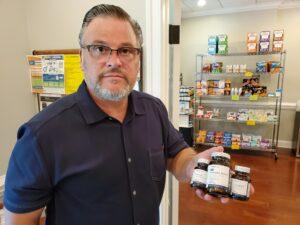 Dr. Simonds holding Metagenics VItamins